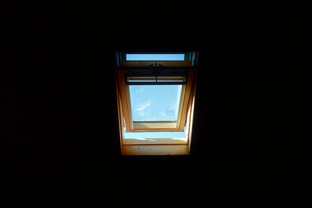 slightly opened window during day
