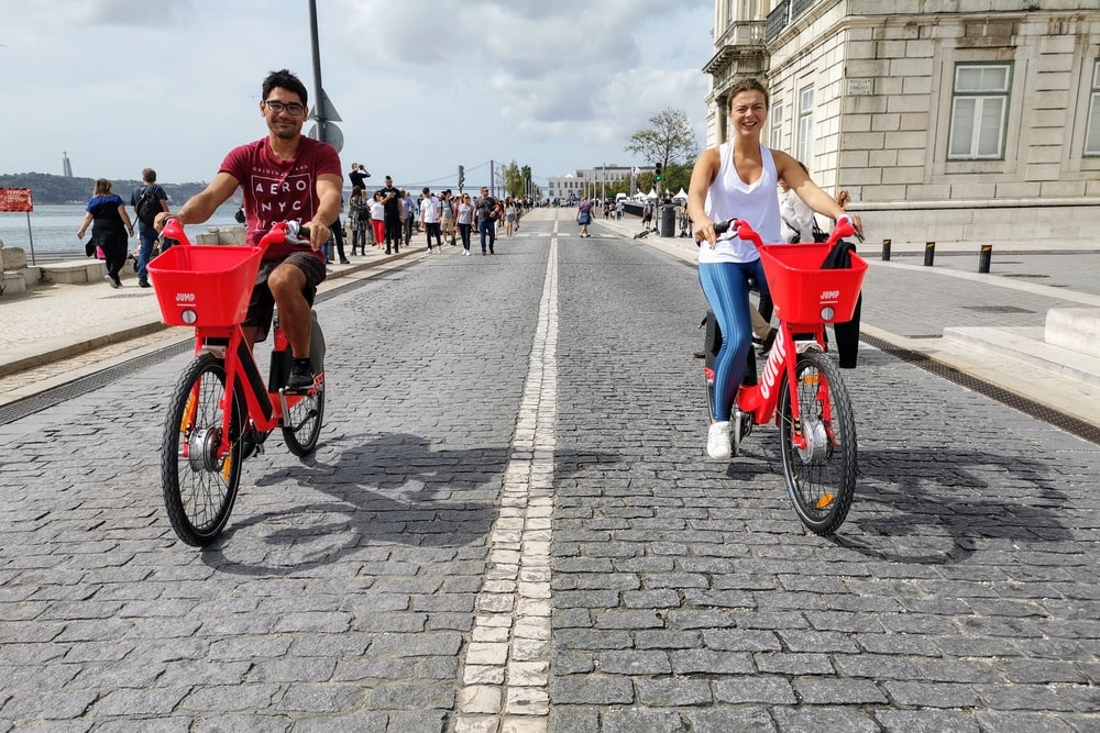 two man and woman driving bicycles