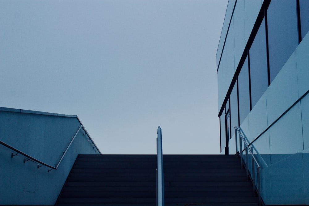 low-angle photography white glass building