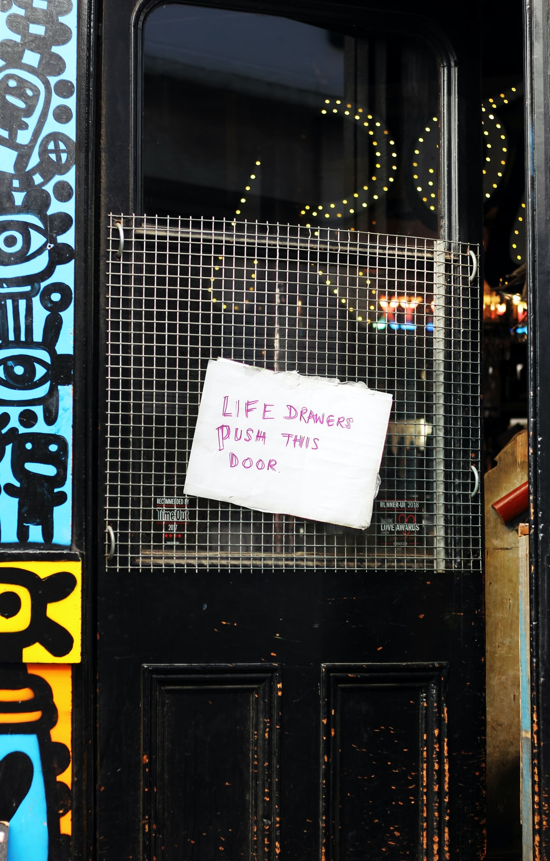 'Life drawers push this door.' The door of a Mexican Bar at Lower Marsh, London.