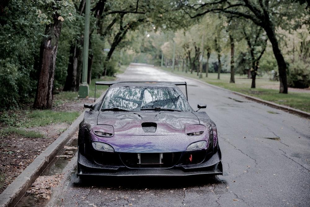 purple lazy eye sports car on road