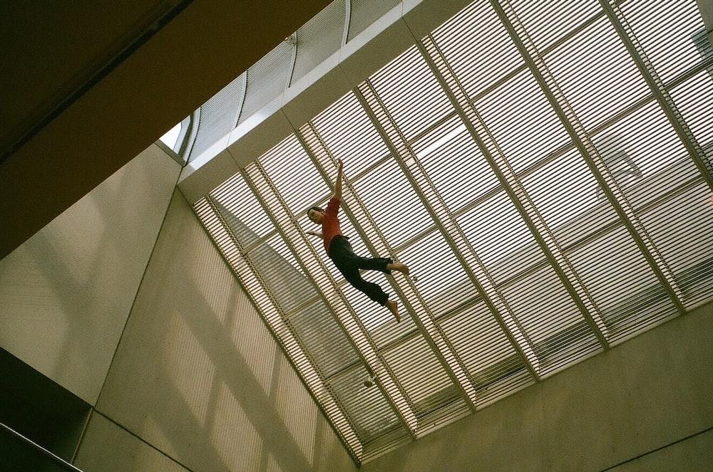 man jumping on air at daytime