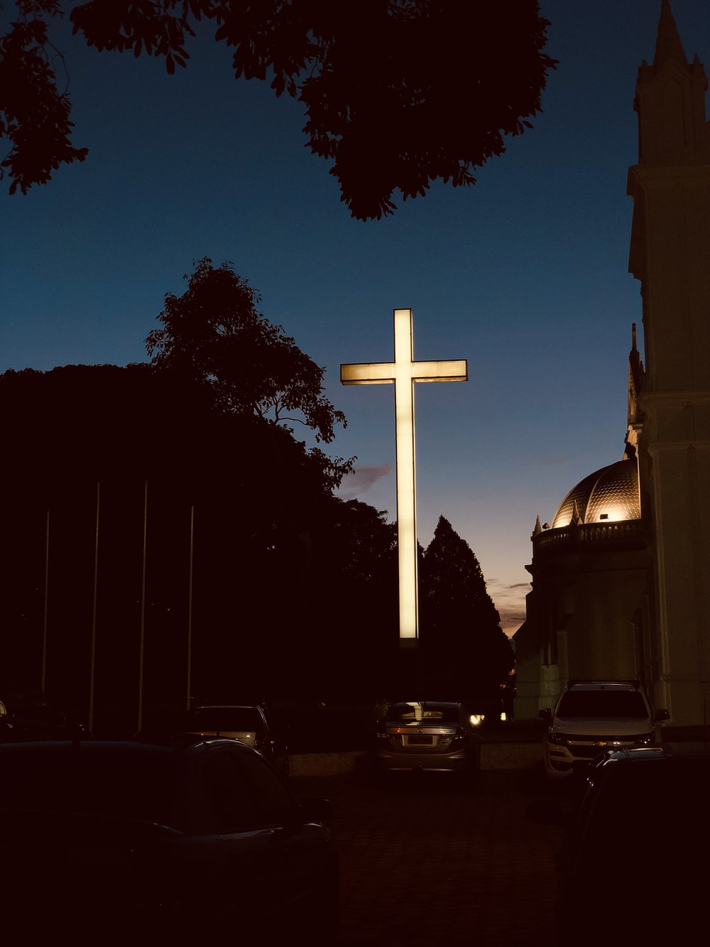 architectural photography of white lighted cross