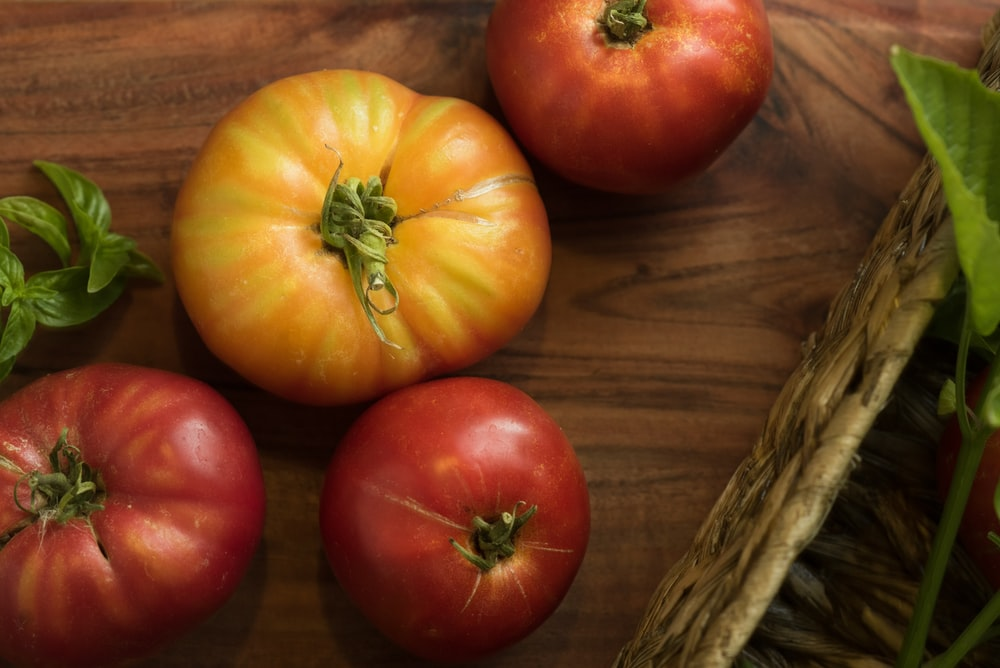 four red and yellow tomato fruits