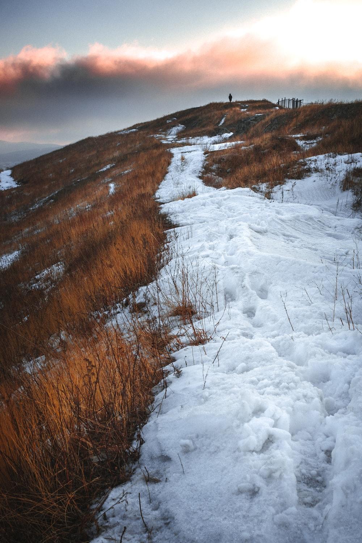 white snow on the mountain during daytime