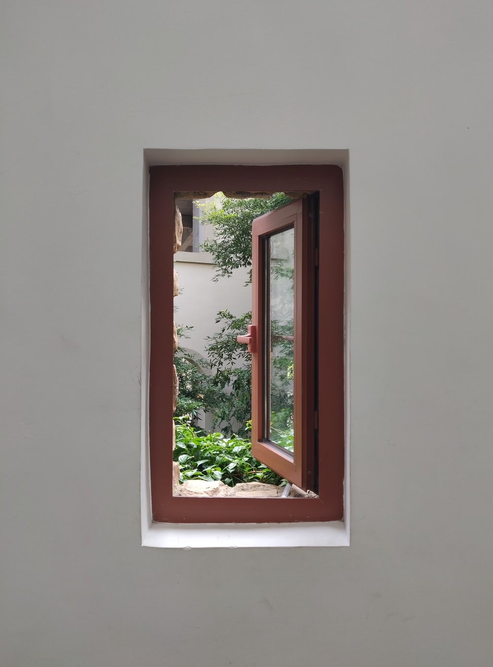 opened brown wooden framed glass window