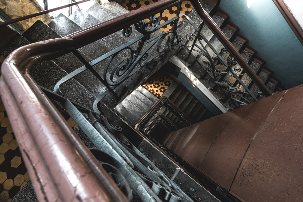 staircae with scrolled metal rail