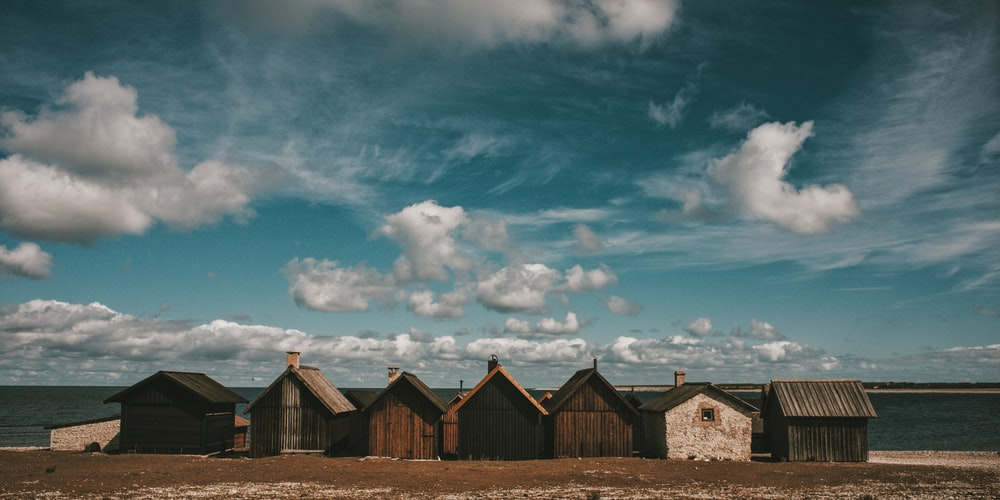 cabins under cloudy sky during daytime
