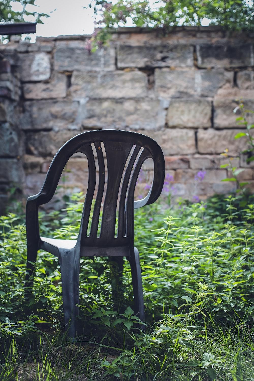 black monoblock chair on grass field