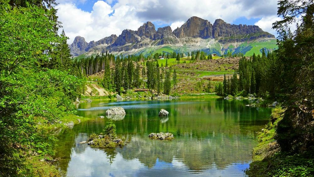mountain ranges beside body of water