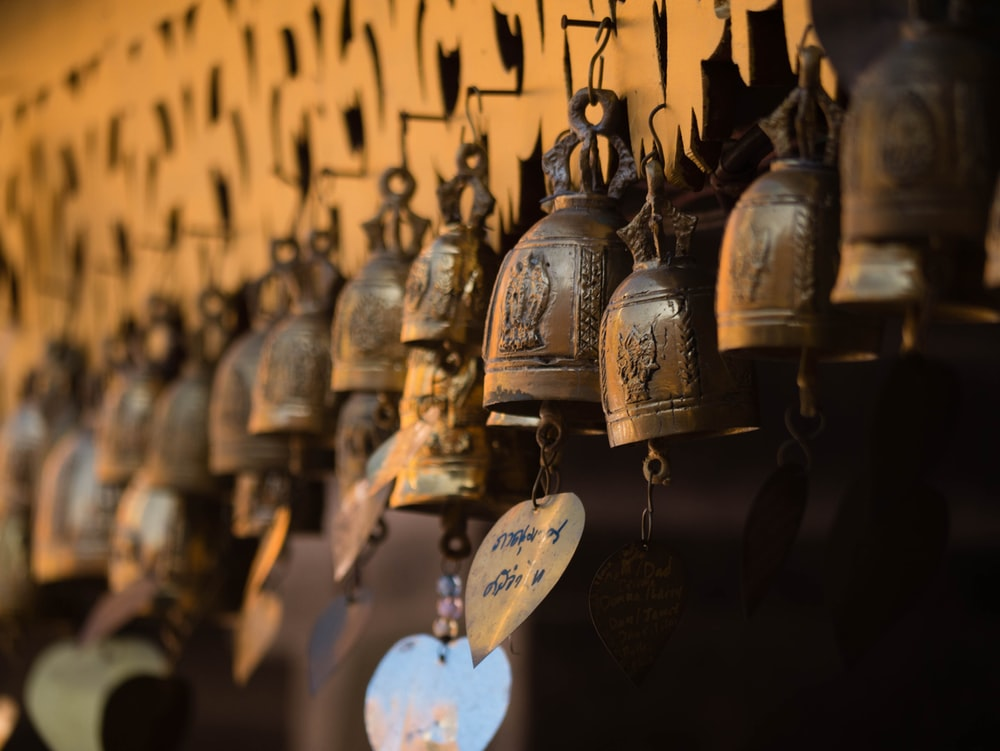 hanging brass-colored bells