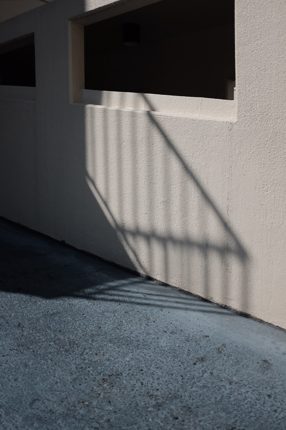 shadow of a stairs railing on white wall