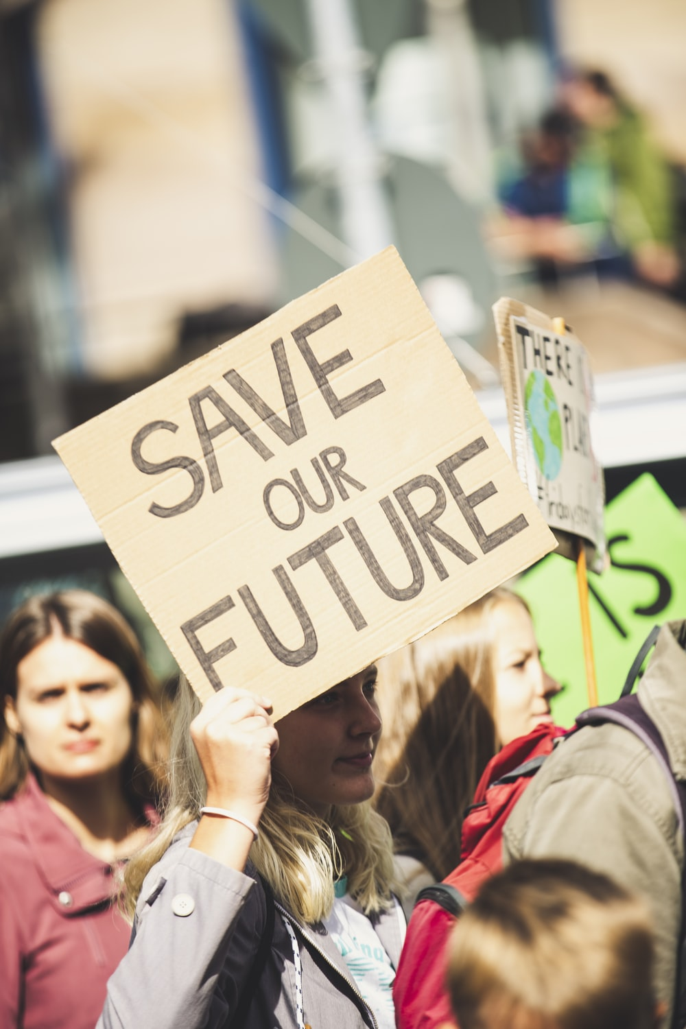 woman holding Save Our Future signage