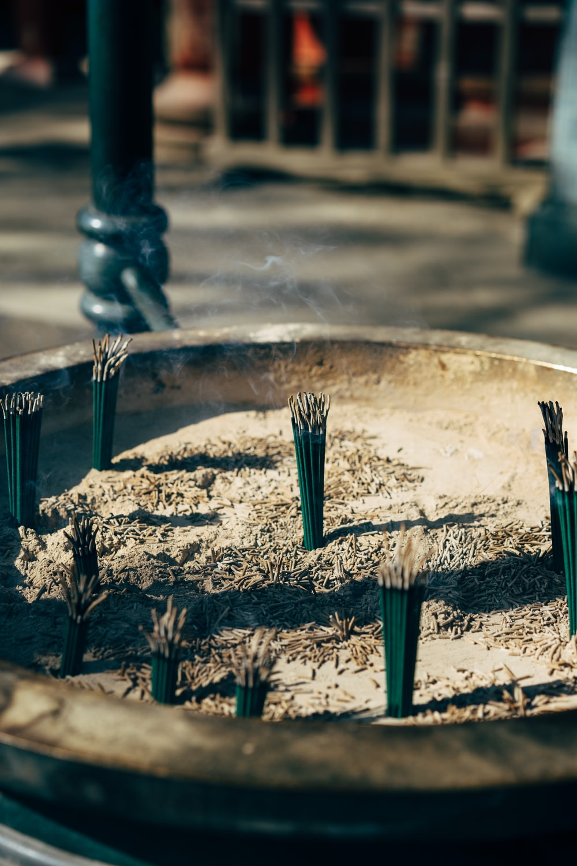 incense sticks in sand