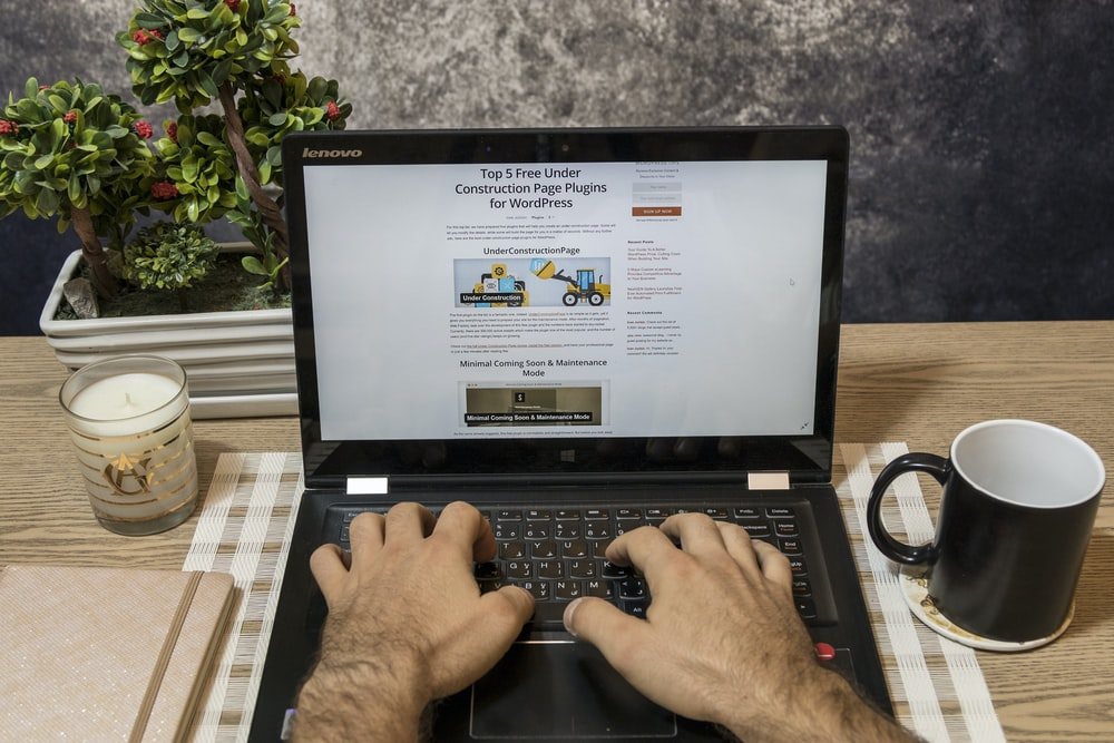 person using laptop computer