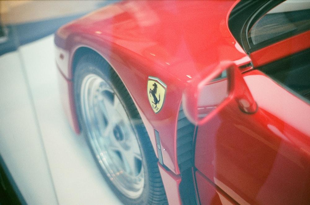 red Ferrari vehicle