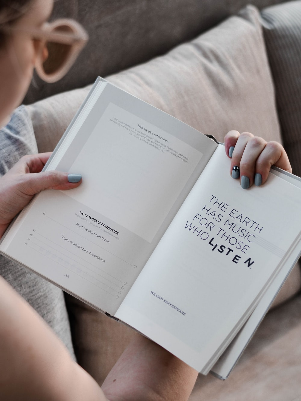 person reading an open book