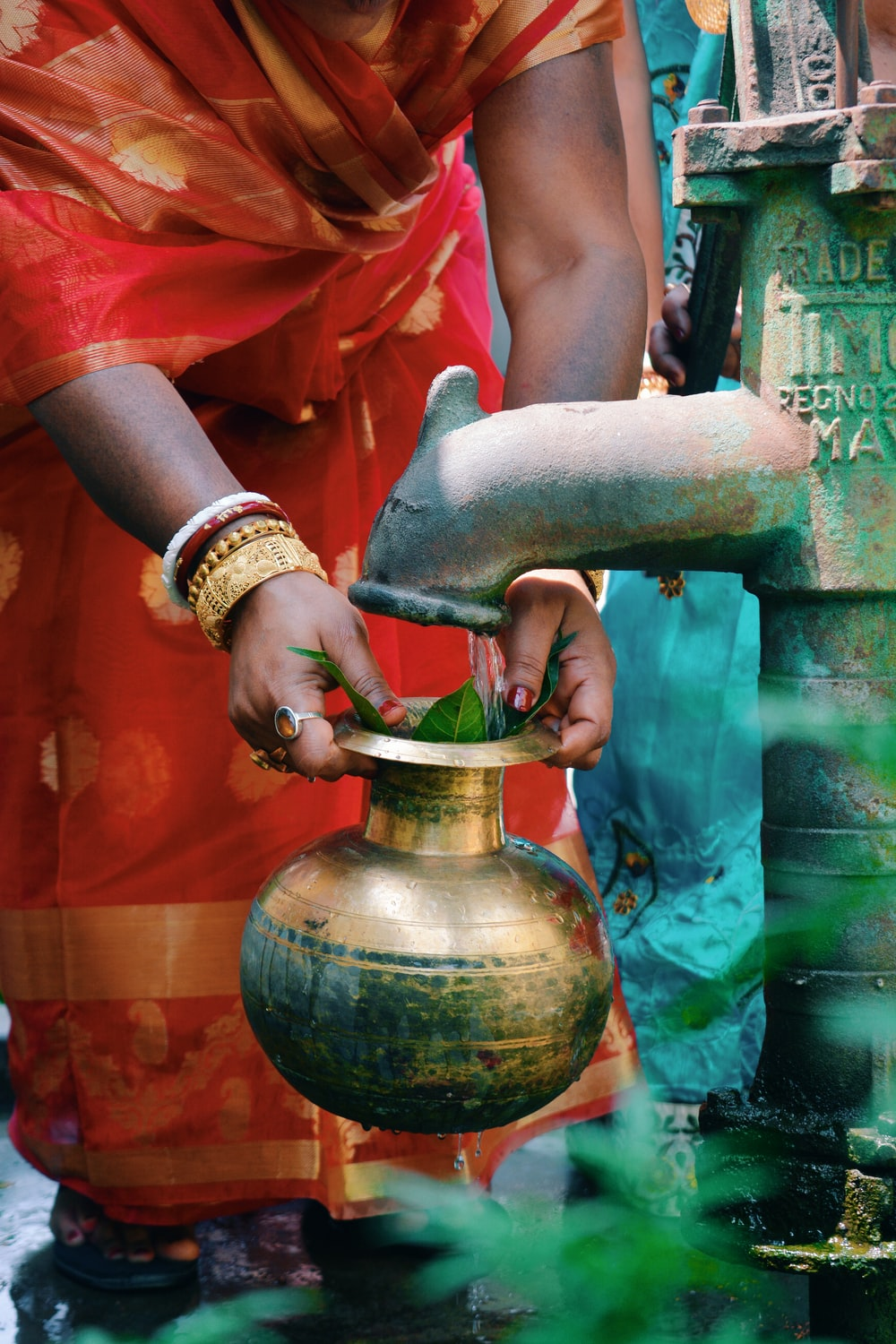 person holding gold pot