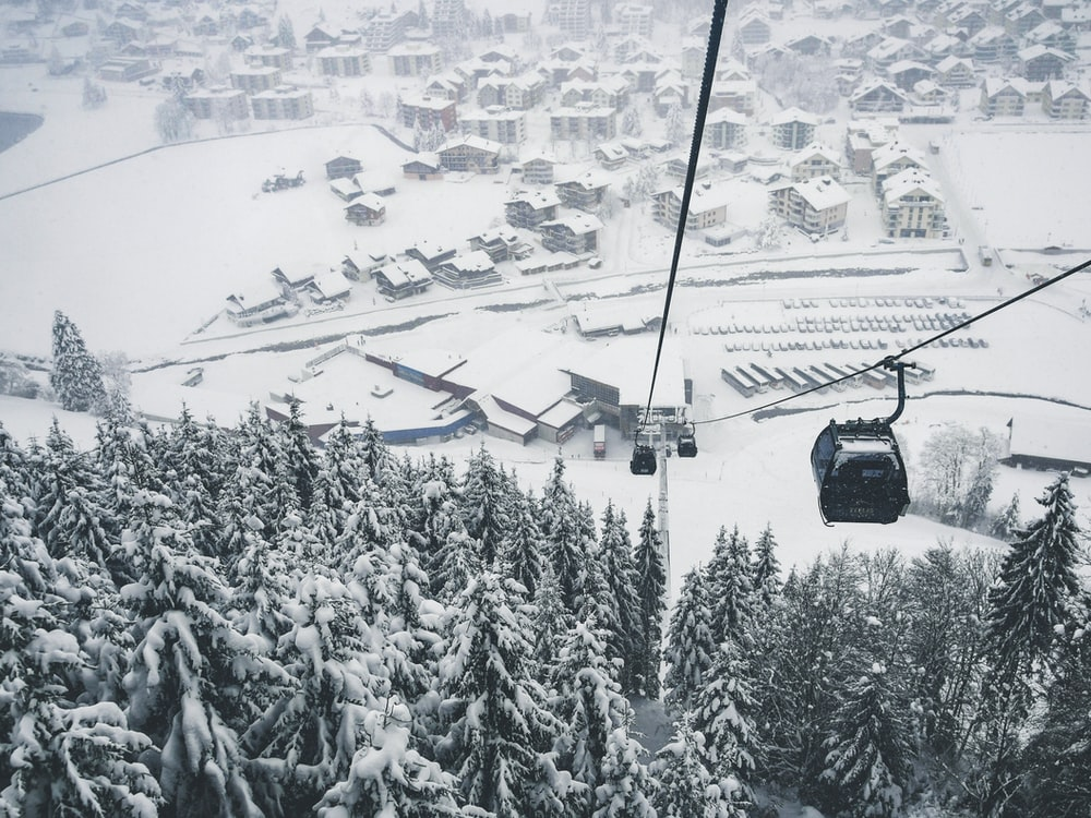 grayscale photography of black cable cars