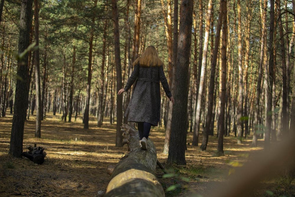 woman walking on the forest