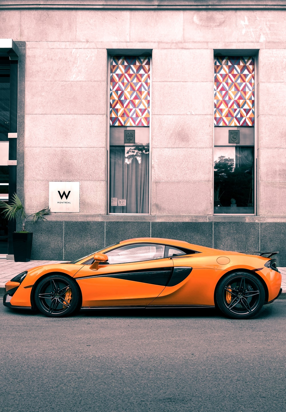 orange Mclaren MPr-12c parked at roadside