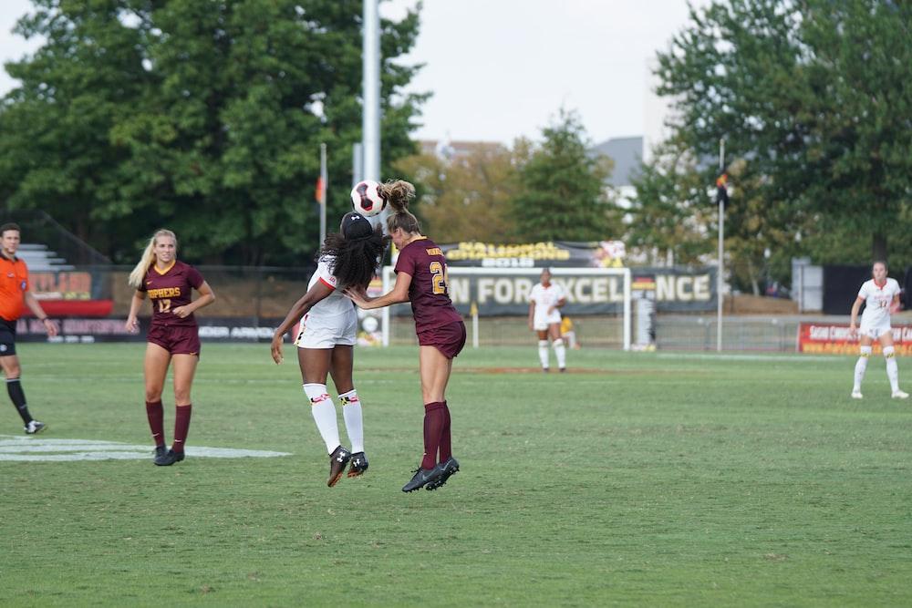 women playing football during daytime