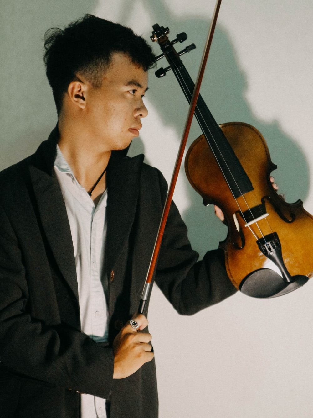 man holding fiddle