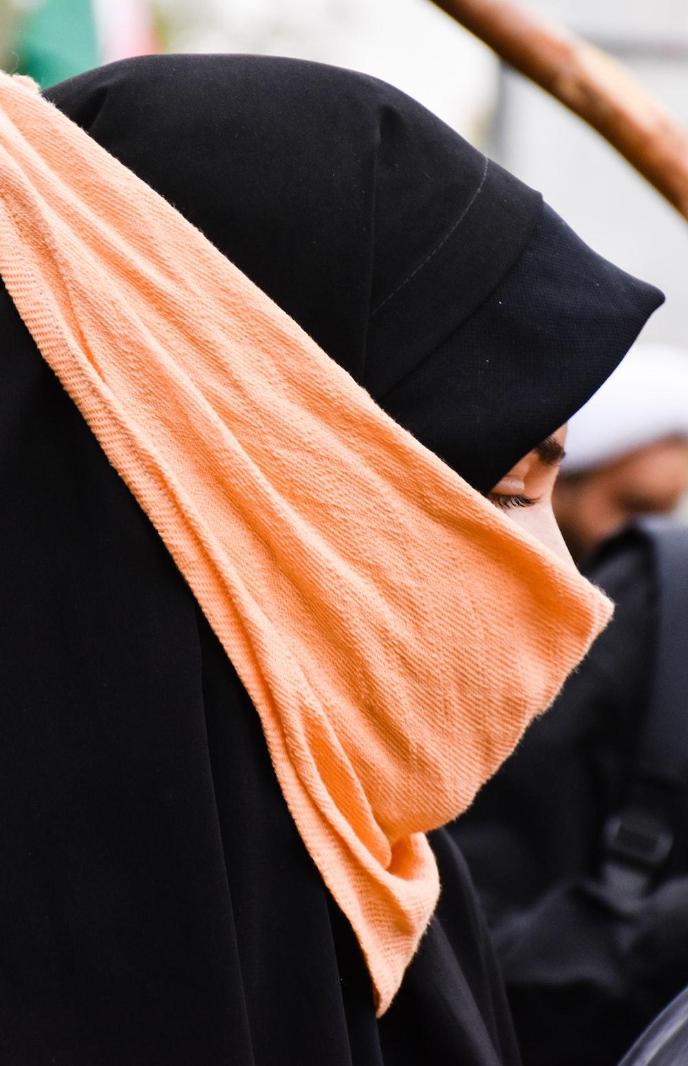 woman wearing black abaya dress