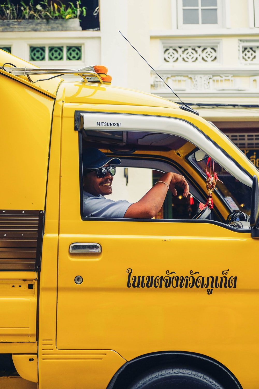 male driver of yellow truck
