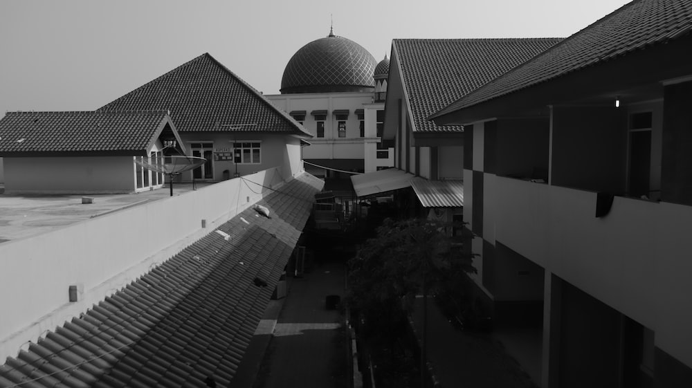 grayscale photography of dome near building