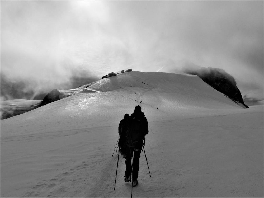 silhouette of man walking on snowfield