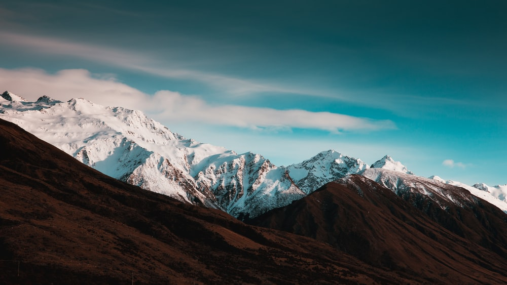 brown mountain blue sky