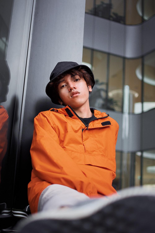 boy in orange jacket
