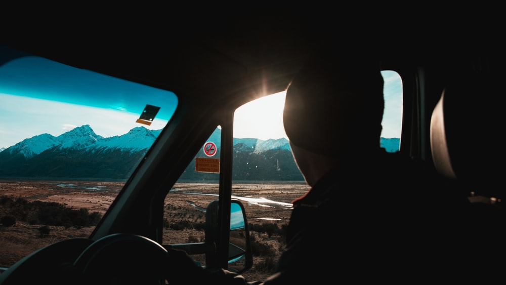 silhouette photography of man inside vehicle