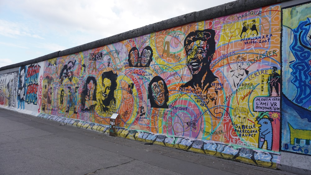 concrete wall with art during daytime photo