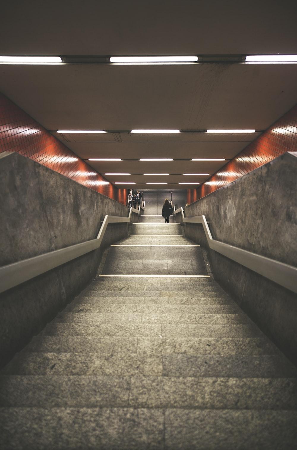 man walking down a staircase