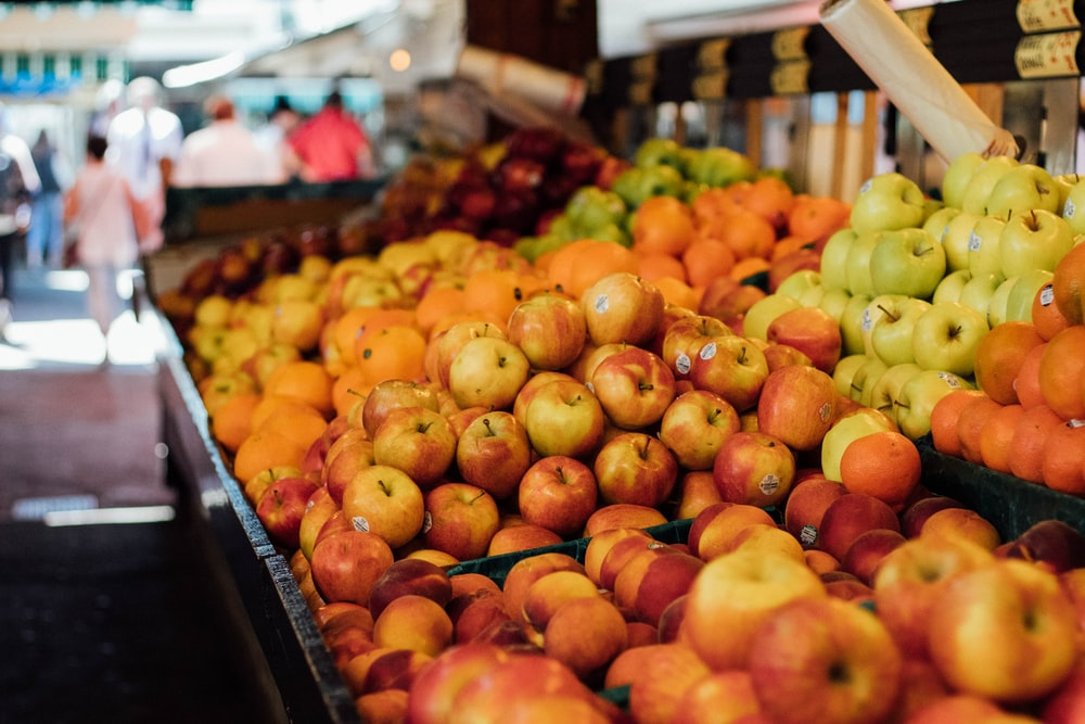 assorted fruits displaying on rack during daytime