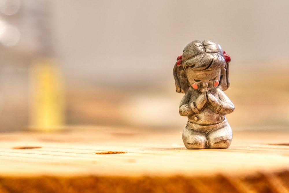 girl kneeling on ground figurine