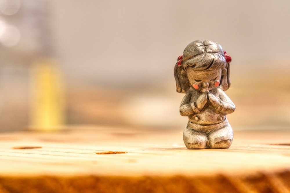 girl kneeling on ground figurine