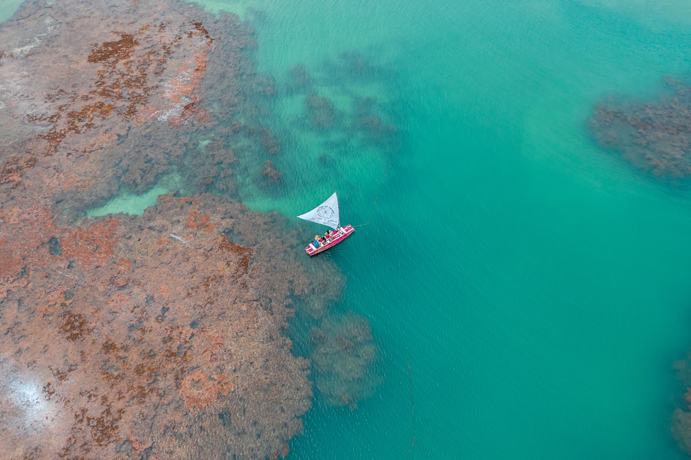 boat on body of water during daytime aerial view photography