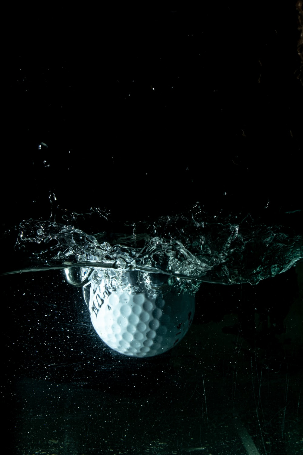 white golf ball on water