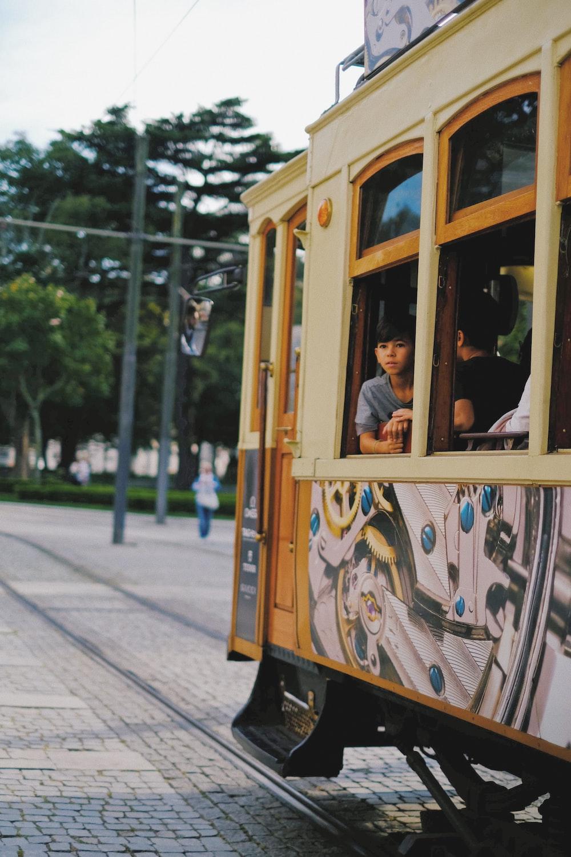 people riding tramp during daytime