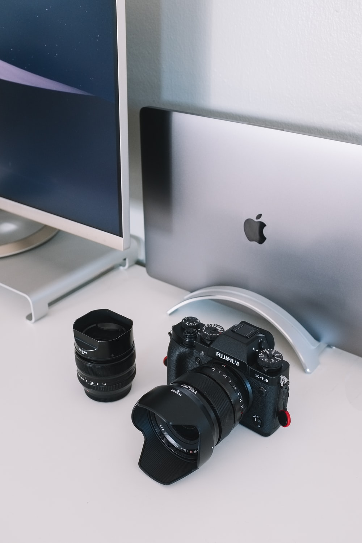 DSLR camera near iMac
