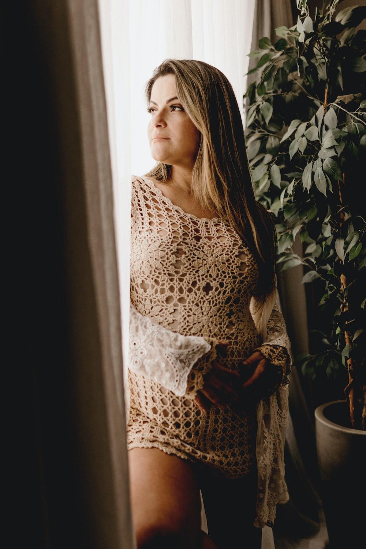 woman standing beside door