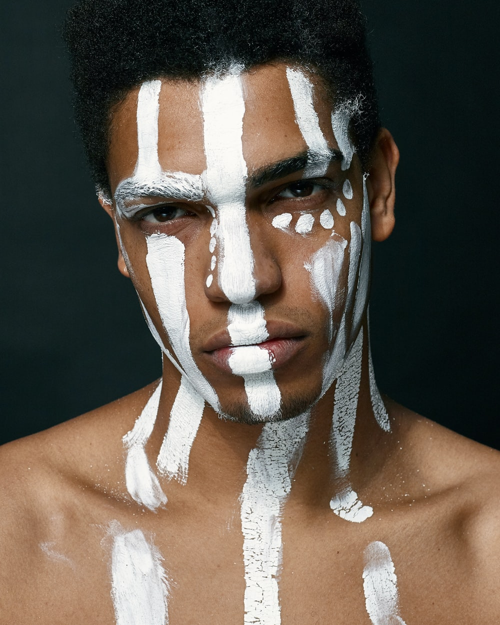 man with white paint on face