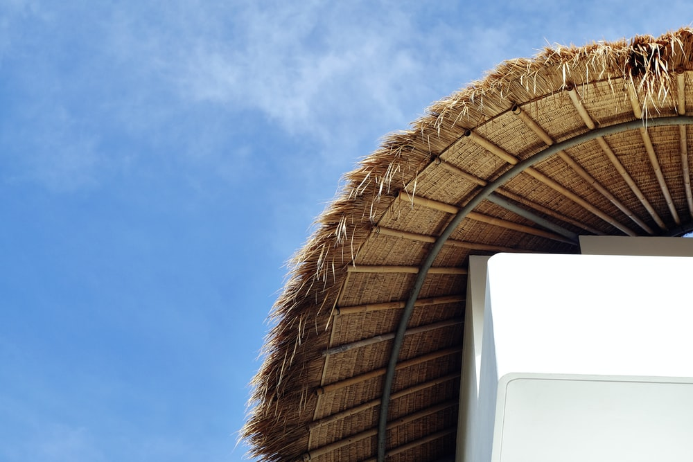 brown hut under clear sky