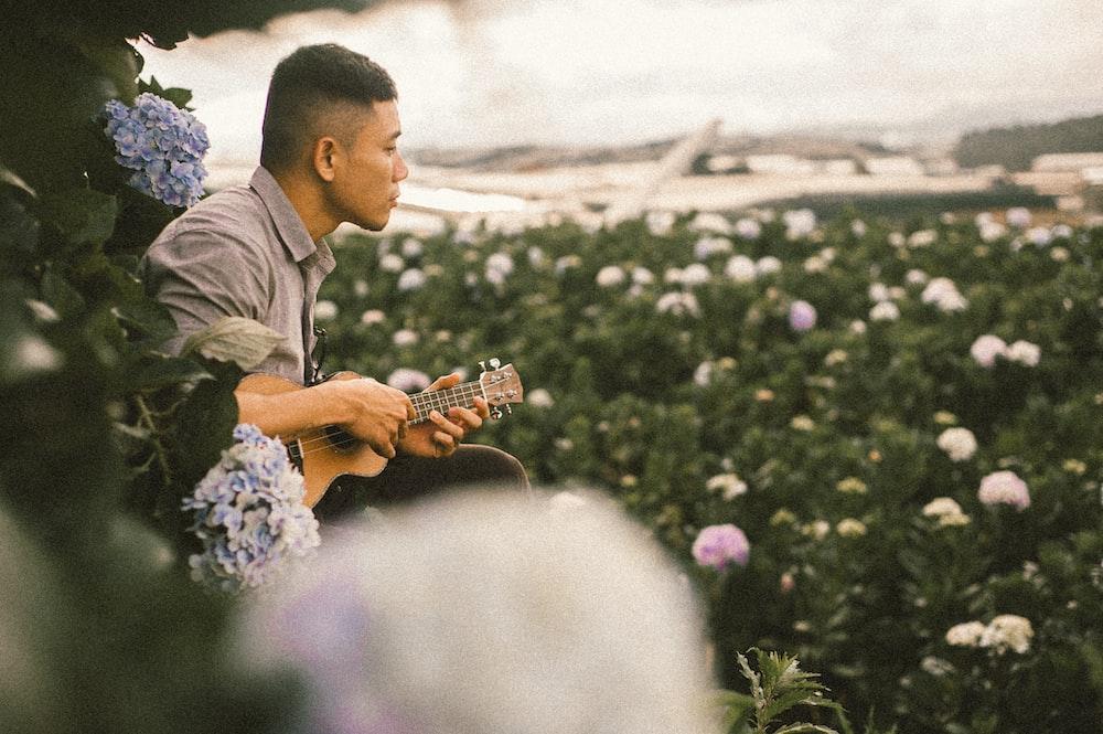 man using ukulele
