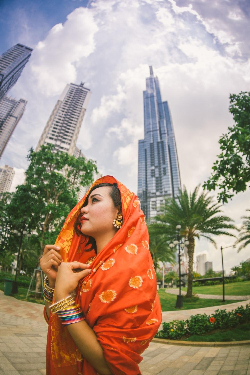 woman wears orange sari dress