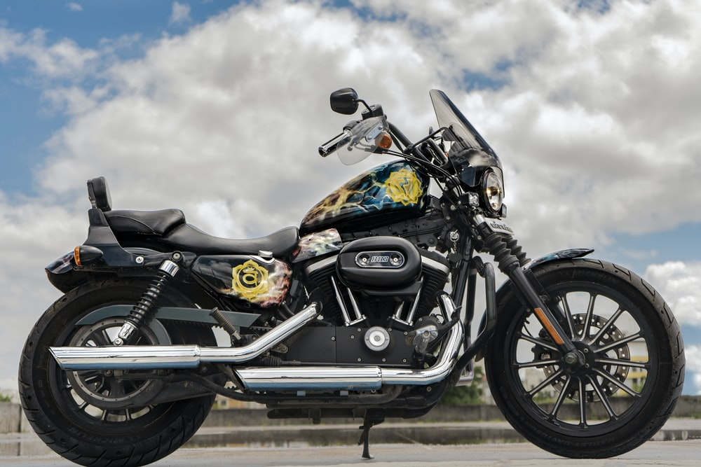 parked black and yellow motorcycle at daytime