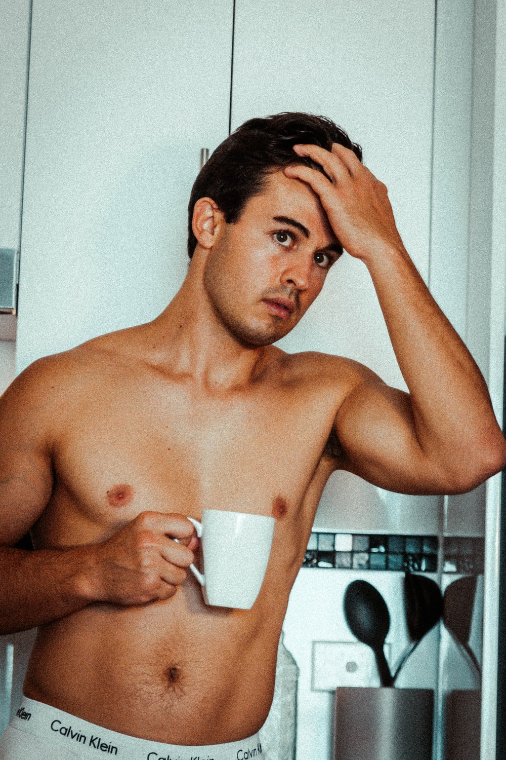 topless man with mug